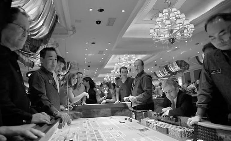 old photo of first casino in the uk. People playing roullette